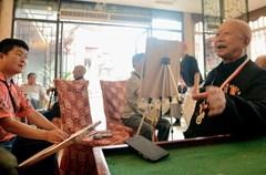 """6月18日,由四川省关爱抗战老兵志愿者组织的""""为抗战老兵画像""""活动在四川省叙永县举行,为来到现场的全县10多名健在的抗战老兵画像,让后人了解历史、铭记历史,以实际行动记录和珍惜和平。"""