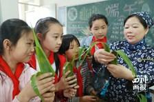 四川广安:娃娃品味民俗迎端午