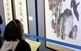"""本次展览展出包括沈鹏、张海、张新建、陈洪武、欧阳中石等在内的70余位中国书画界领军名家和""""大千故里""""知名书画家的近200件作品,是内江书画展览史上罕见的一次阵容强、水准高、质量精的展览。"""